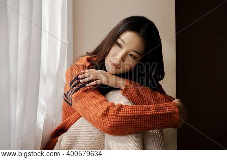 Depressed Sad Girl Feeling Lonely Sitting By Home Winter Looking Out The Window In Cold Weather Wint