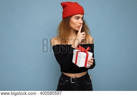 Charming Happy Adult Dark Blonde Curly Woman Isolated Over Blue Background Wall Wearing Stylish Blac