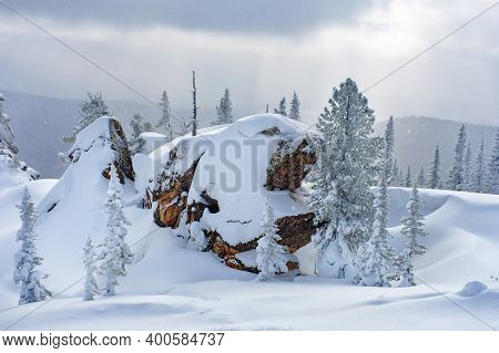 Sheregesh Ski Resort In Russia. Winter Landscape, Trees In Snow, Clouds And Big Beautiful Stone Bloc