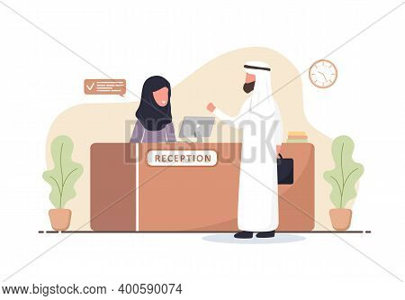 Reception Interior. Arabic Woman Receptionist In Hijab. Arab Man At Reception Desk. Hotel Booking, C