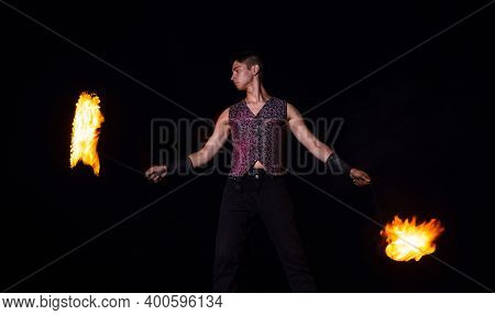 Fire Performer Man Perform Burning Poi Spinning In Darkness Outdoors, Performing