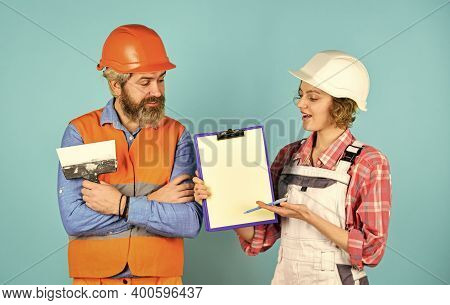 Sign Contract With Workers. Price List. Couple Look Documents. Couple Planning Changes Renovation Ap