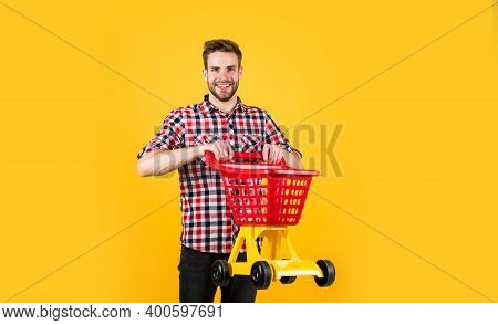 Successful Shopping Day. Male Shopper With Shopping Cart. Bearded Guy In Checkered Shirt Do Purchase