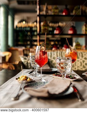 Served Table With Aperitif Cocktails And Appetizer