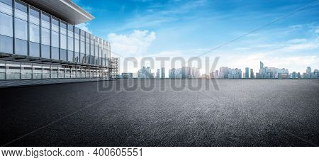 Panoramic Skyline And Buildings With Empty Space Dark Concrete Square Floor. Sunrise Over The City V