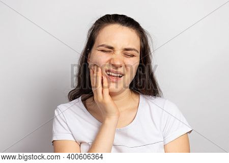 The Woman Suffers From Toothache - Tooth Decay Or Pulpitis, Inflammation, A Filling Fell Out Or A Br