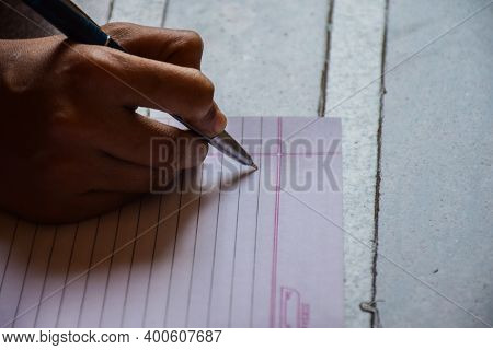 Hand Of A Women Writing Notes On A Paper In Office