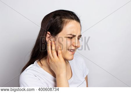 The Woman Has A Sore Ear - Infection, Inflammation From Infection And Otitis. Perforation Ruptured T