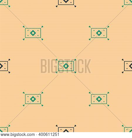 Green And Black Magic Carpet Icon Isolated Seamless Pattern On Beige Background. Vector