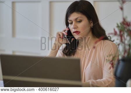 Young Woman Doubting Or Thinking, Biting Lip And Feeling Insecure And Nervous. Pretty Lady Working W