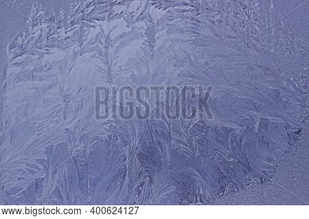 Frosty Original Pattern On Winter Glass, Natural Texture. Blue Frosty Glass Ice Background. Winter C