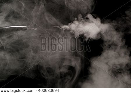 Mist And Smoke Blowing From Pipes Showing Patterns And Swirls