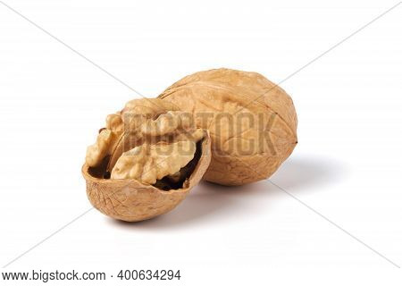 Walnuts Isolated On White. Walnut In A Nutshell
