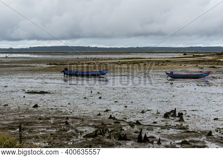Carrasqueira, Portugal - 19 December 2020: Two Colorful Fishing Boats Stranded In The Marsh At Low T
