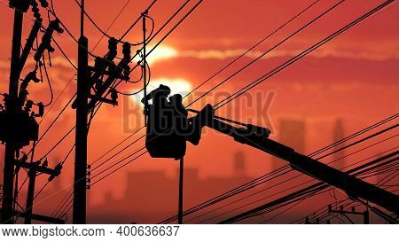 Silhouette Two Electricians With Disconnect Stick Tool On Crane Truck Are Working To Install Electri