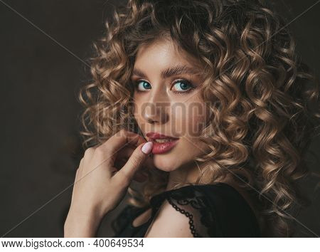 Beautiful Woman Looking At The Camera, Curly African Hairstyle. Beautiful Girl With Curly Hair.