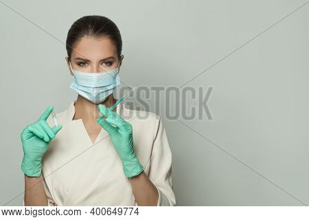 Vaccination Concept. Doctor Or Nurse With Syringe And Ampoule Injecting On White Background