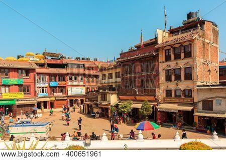 Kathmandu, Nepal - November 17, 2018: People Walking On The Square Near Boudhanath Stupa In Kathmand
