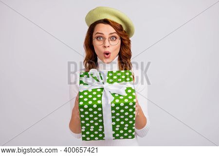 Portrait Of Lovely Amazed Cheery Wavy-haired Girl Holding In Hands Giftbox Pout Lips Isolated Over L