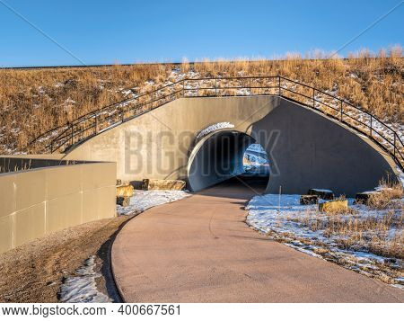 bike trail and tunnel under railroad, fall or winter scenery - part of extensive trail system in Fort Collins, Colorado