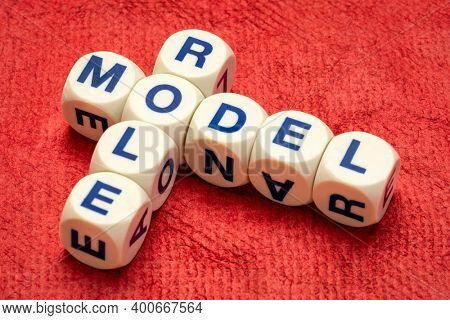 role model crossword in letter dices against textured handmade paper, inspiration and leadership concept