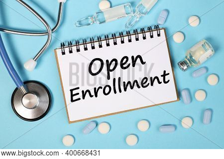 Open Enrollment, Text On White Paper On Blue Background