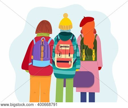 Young People With Backpacks Dressed In Winter Clothes, Back View. Group Of Young People Goes On A Tr