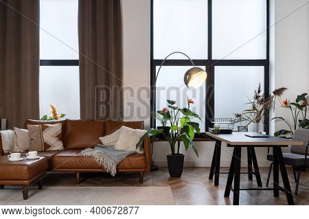 Comfortable Home Office In Modern Apartment. Cozy Living Room With Leather Couch, Cups With Beverage