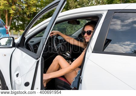 Woman In Summer Opens And Closes Car Door, Sits In Car, A White Sedan, A Beautiful Girl Smiles, Hold