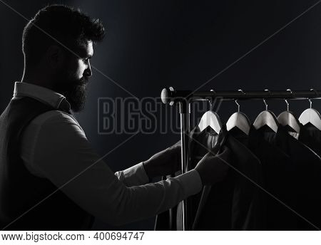 Men Clothing, Boutiques. Tailor, Tailoring. Stylish Mens Suit. Man Suit, Tailor In His Workshop. Han