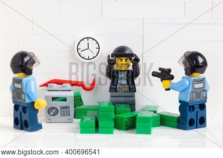 Tambov, Russian Federation - December 23, 2020 Two Lego Minifigure Police Officers Arresting A Burgl