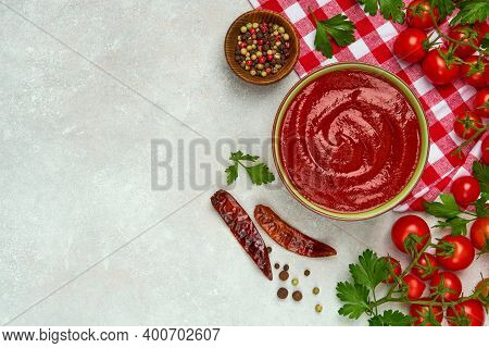 Bowl Of Tomato Sauce And Cherry Tomatoes . Top View, Copy Space