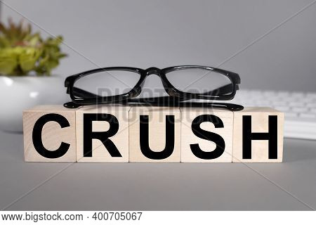 Crush, Text On Wood Cubes On A Gray Background Near Plants