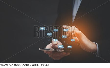 Businessman Hands Using Mobile Smartphone And Laptop With Icon Social Media And Marketing, Person Ha