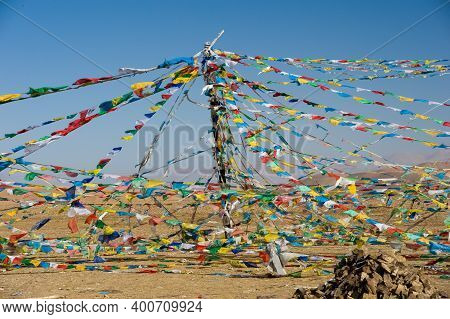 Colored Rags On A Rope In Tibet. Rituals And Beliefs.