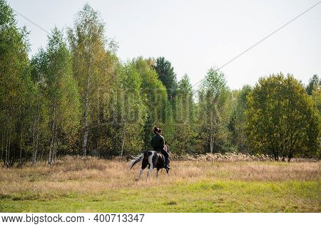 On A Warm Autumn Day, A Young Girl Went Out To Ride Her Mare On Horseback Around The Farm.