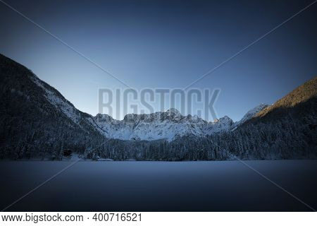 The Panorama Of The Lake Of Fusine, Tarvisio, Frozen In Winter