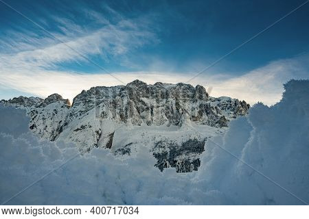 Panoramic View Of The North Face Of Mount Jof Di Montasio Covered With Snow In Winter