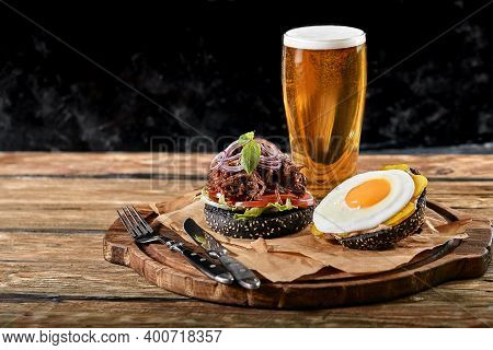Set Of Hamburger With Egg And Beer. A Standard Set Of Drinks And Food In The Pub, Beer And Snacks. D