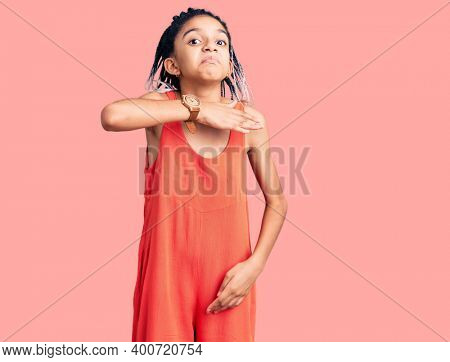 Cute african american girl wearing casual clothes cutting throat with hand as knife, threaten aggression with furious violence
