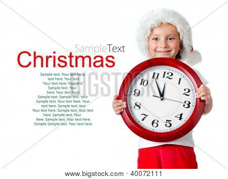 cute little girl in santa cap and clock isolated oin white with sample text