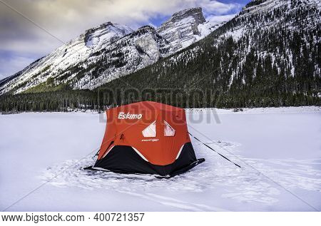 December 15 2020, Spray Lakes Alberta Canada: An Eskimo Ice Fishing Tent Set Up On A Frozen Lake At