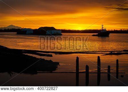 Sunrise Tugboat Fraser River. A Tugboat Working On The Fraser River At Sunrise In British Columbia,