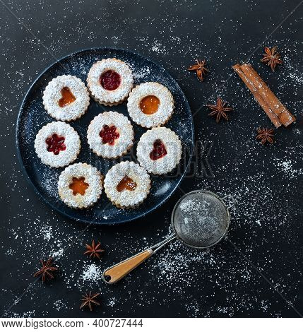 Homemade Christmas Linzer Cookies With Apricot And Strawberry Jam On Dark Background. Top View. Flat