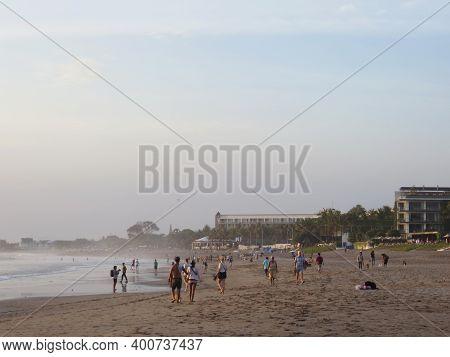 Badung Bali, Indonesia - October 12, 2019: People Having Activities On Petitenget Beach During Sunse