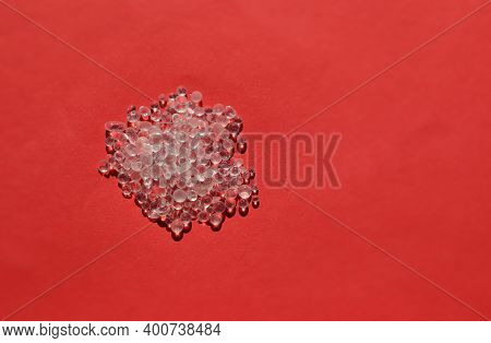 Closeup Of Silica Gel Isolated On Red Background With Copy Space For Texts Writing
