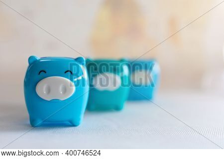 Blue Piggy Bank With Money Saving Concept.