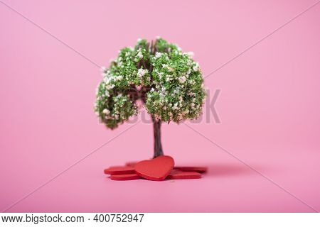 Artificial Tree And Hearts On A Pink Background.
