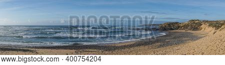 Panorama View Of A Wild And Empty Beach On The Atlantic Coast Of Portugal