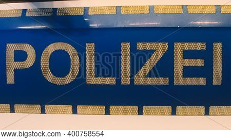 German Police (polizei) Sign In White Letters On A Police Car
